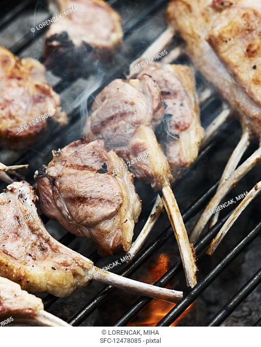 Racks of lamb on a barbecue