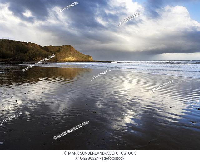 Clouds Reflected in Wet Sand at Osgodby Point or Knipe Point Cayton Bay Scarborough North Yorkshire England