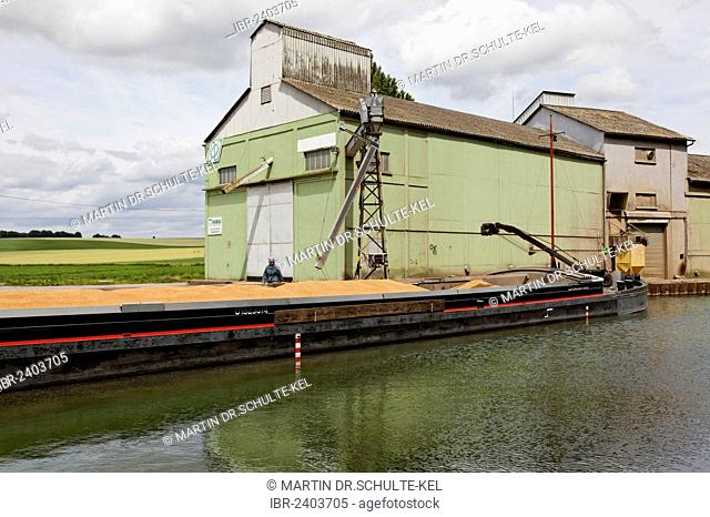 Canal of Saint-Quentin near Bellenglise, grain being loaded from a silo, Saint-Quentin, department of Aisne, Picardy region, France, Europe
