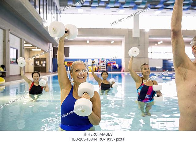 Water aerobics class at indoor swimming pool