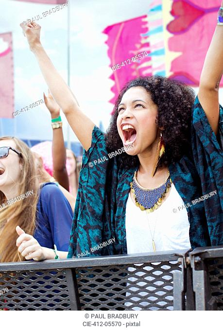 Woman cheering at music festival