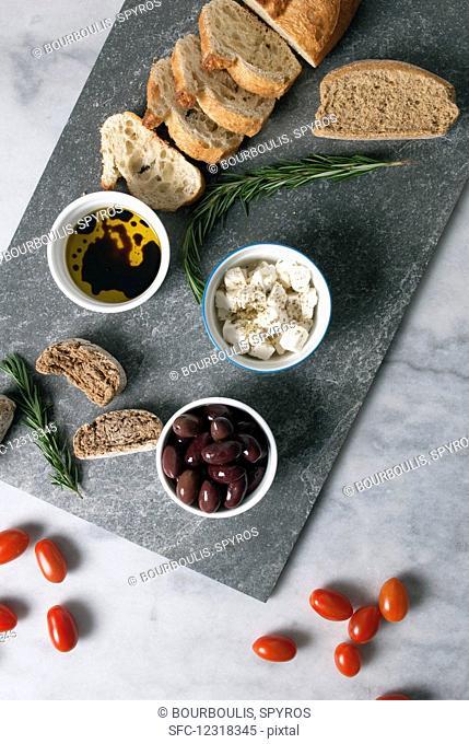 Greek mezze: olives, feta, olive oil and bread