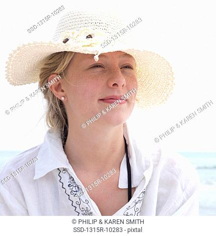 Italy, Portrait of teenage girl wearing hat