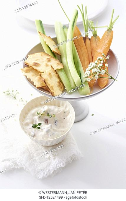 Sheep's cheese and olive dip with raw vegetables (cucumber, celery, carrots)