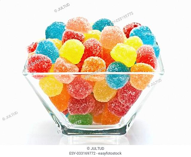 colored jellybeans covered granulated sugar