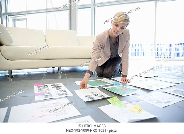 Creative businesswoman reviewing proofs in office