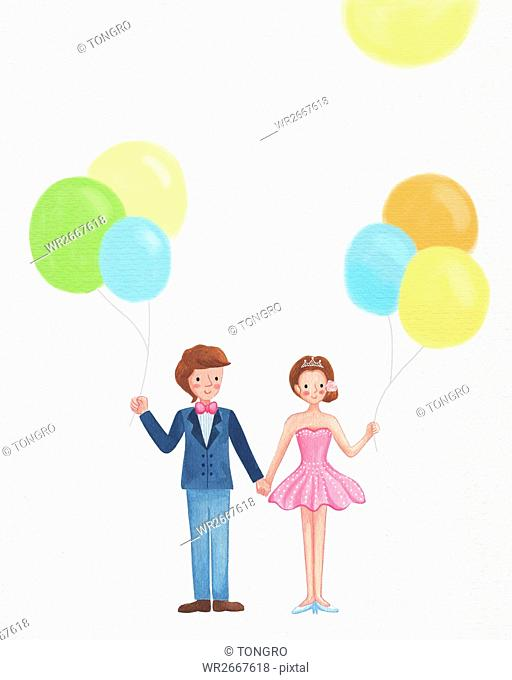 Smiling wedding couple with balloons standing hand in hand