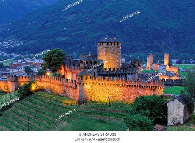 Illuminated castle Castello di Montebello and castle Castelgrande in background in UNESCO World Heritage Site Bellinzona, Bellinzona, Ticino, Switzerland