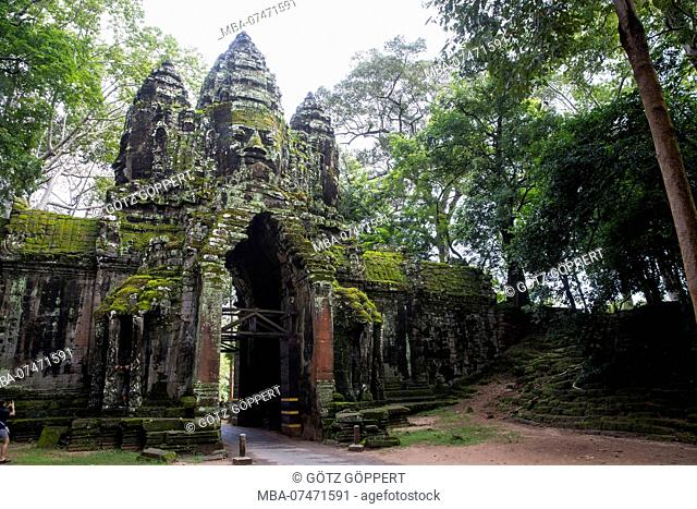 Siem Reap, Angkor, a gate of Angkor Thom, a former city that was the size of Manhattan, is now a tourist attraction