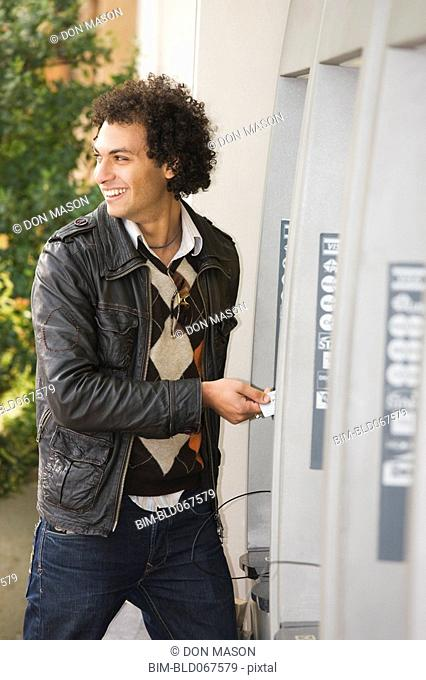 Middle Eastern man at ATM