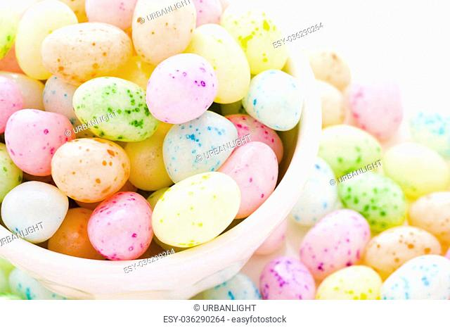 Assorted jelly beans in pastel colors with darker spots