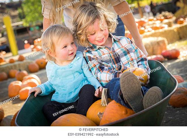 Adorable Young Family Enjoys a Day at the Pumpkin Patch