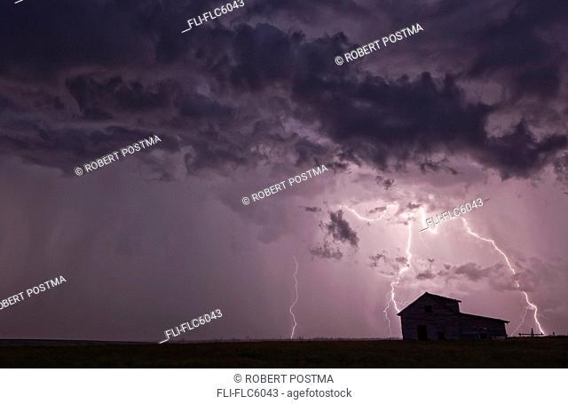 Thunderstorm over abandoned farmhouse, Val Marie, Saskatchewan, Canada
