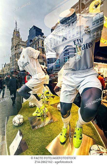 Mannequins and reflections at Real Madrid Official Store window shop at Gran Via street. Madrid. Spain