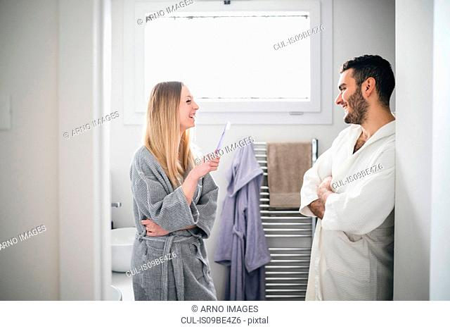 Couple in bathroom chatting