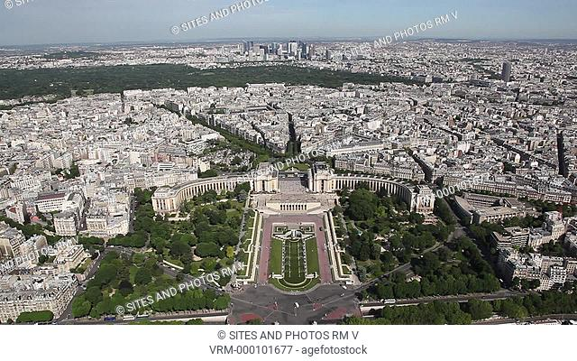 Locked down Shot, LS, HA, Daylight. The Trocadero Gardens, enclosed by the pavilions of the Palais de Chaillot. View from the Eiffel Tower