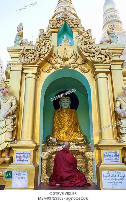 Myanmar, Yangon, Shwedagon Pagoda, Buddha Statue and Monk