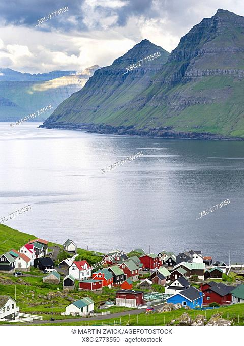 Village Funningur , in the background Funningsfjordur, Leiriksfjordur and the island Kalsoy. The island Eysturoy one of the two large islands of the Faroe...