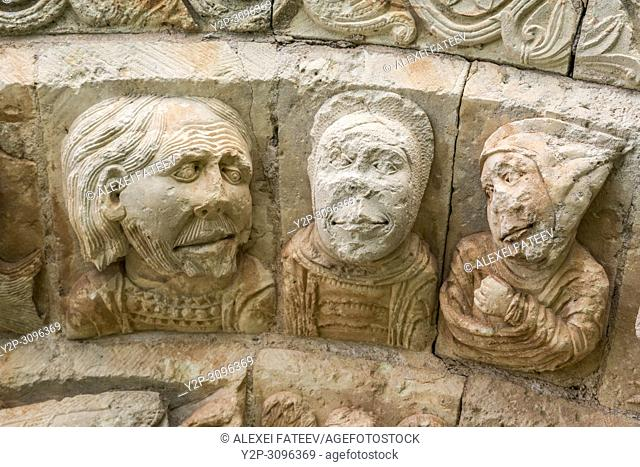 Heads of 3 men - relief from South portal of Romanesque church San Andrésin Soto de Bureba, province Burgos, Castile and Leon, Spain