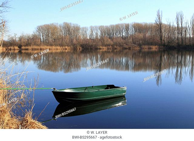 landscape at the Old Rhine with a boat roped at the riverside on a sunny winter day, Germany