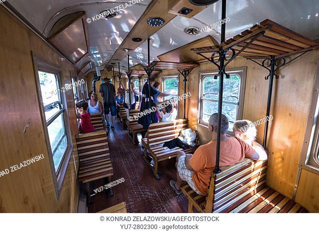 Tourists in Sargan Eight narrow-gauge heritage railway wagon in Serbia, runs from Mokra Gora village to Sargan Vitasi station