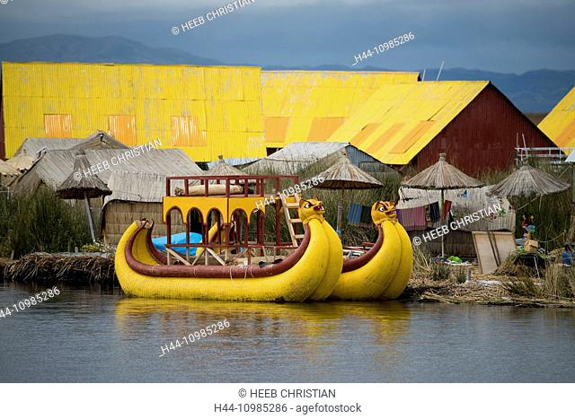 Suasi Island and yellow boats on Lake Titicaca, Peru
