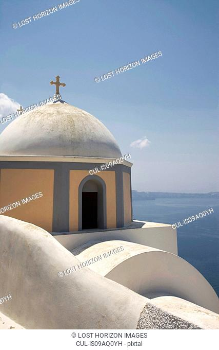 View of domed church and sea, Oia, Santorini, Cyclades, Greece