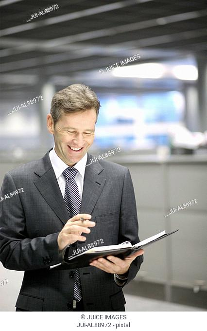 Businessman looking at date book