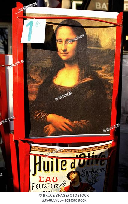A Mona Lisa poster for sale for 1 euro in a street of Paris. France