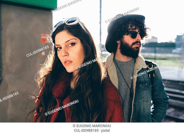 Portrait of young couple on train platform