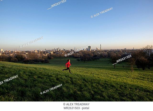 Lizzy Hawker, a world record holding extreme athlete, training on Primrose Hill, London, England, United Kingdom, Europe