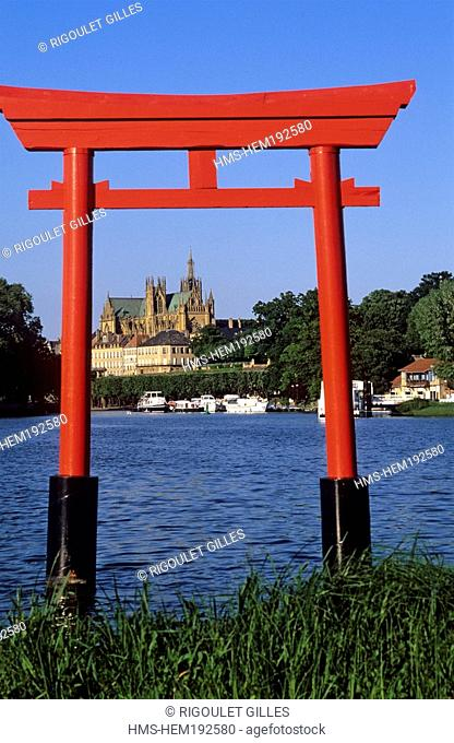 France, Moselle, Metz, pond on the River Moselle, a Torii Gate and the Saint Etienne Cathedral in the background