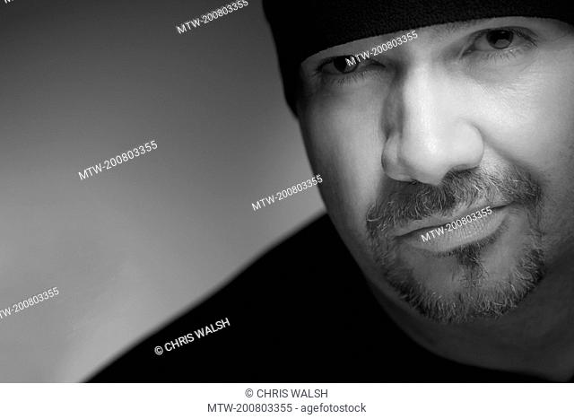 Black and white portrait man woollen hat beard