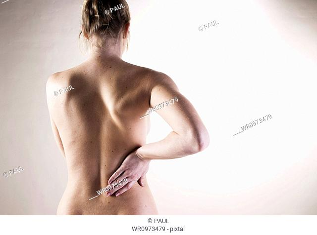 Young woman with pain in the back