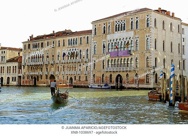 View of the Grand Canal in Venice with a gondola passing tourists