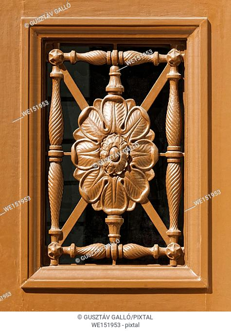 Carved wooden floral pattern decorative door window