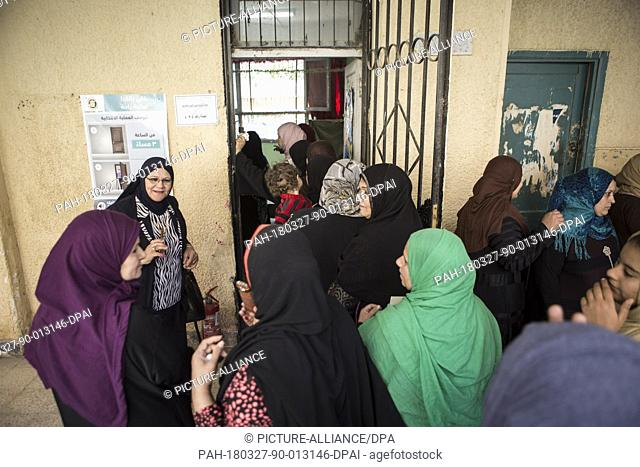 Egyptian women queue up outside a polling station to cast their votes at a polling station on the second day of the 2018 Egyptian presidential elections
