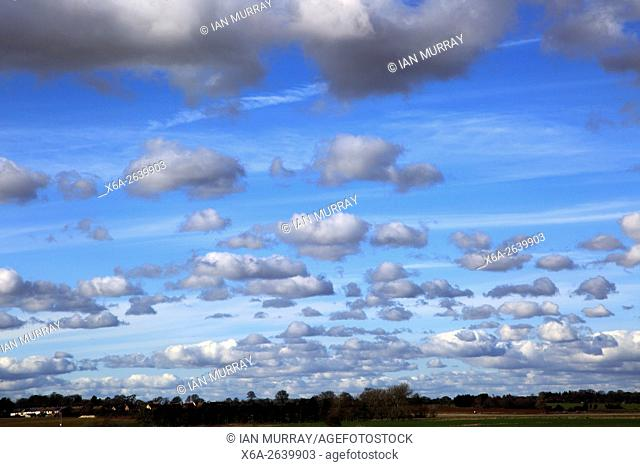 Cumulus clouds in blue sky over Bawdsey and Alderton, Suffolk, England, UK