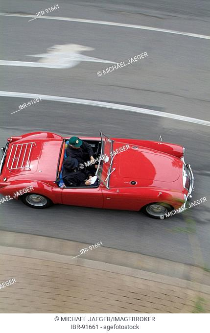 Red vintage car MG driving and from above