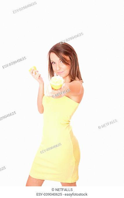 happy model eating an lemon over white background