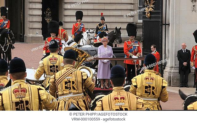 The Monarch Queen Elizabeth reviews her Guards on her Official Birthday, as they march and ride past her as she stands outside at Buckingham Palace in London