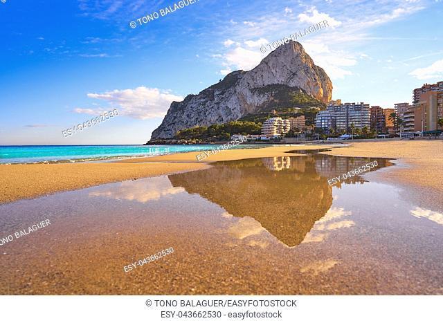 Playa de Fossa beach in Calpe and Ifach penon rock of Alicante in Spain