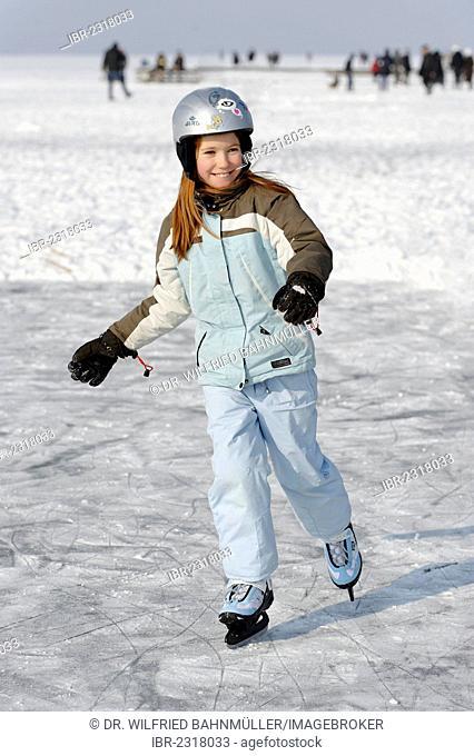 Girl ice skating near St. Heinrich, Lake Starnberg, Five Lakes region, Upper Bavaria, Bavaria, Germany, Europe