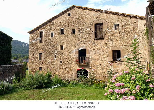Masia (Catalan typical farmhouse), built in the 12th century with subsequent additions until 18th century. La Garrotxa. Spain