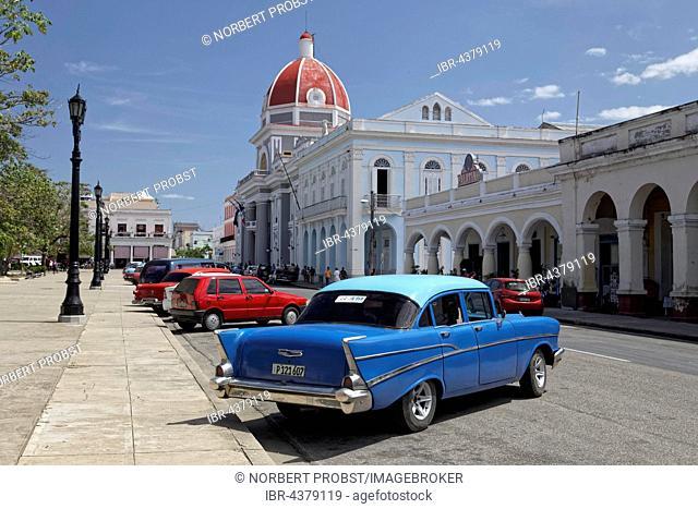 Vintage car Chevrolet Bel Air 1957 at Parque Jose Marti, in the background the town hall, historic city centre, Cienfuegos, Cienfuegos Province, Cuba