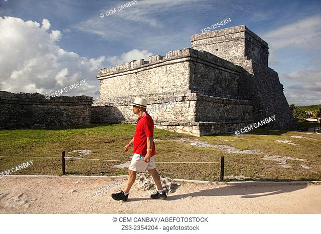 Tourist in Mayan Ruins at Maya archeological site of Tulum, Quintana Roo, Yucatan Province, Mexico, Central America