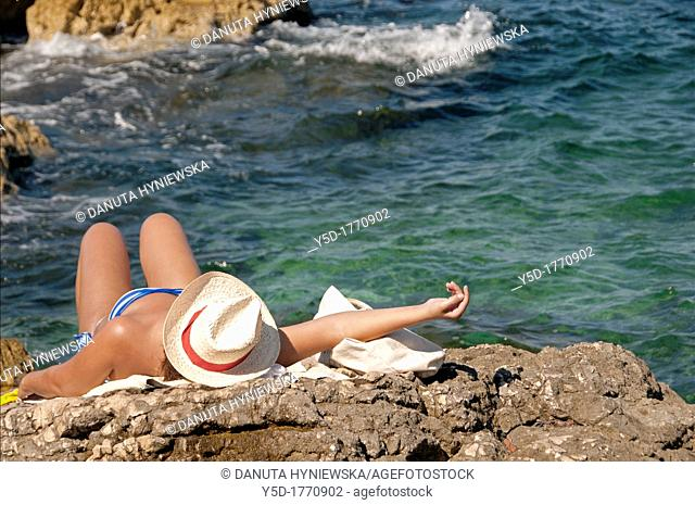woman resting, sunbathing on the cliff, Samena calanque, Mediterranean Sea, Marseille, Bouches-du-Rhone, Provence- Alpes-Cote d Azur, France, Europe