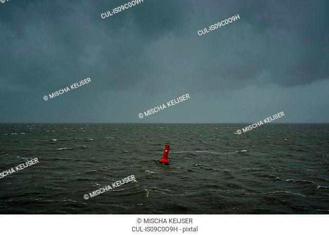 Seascape with heavy rain and hail over the Waddensea in winter, Hollum, Friesland, Netherlands