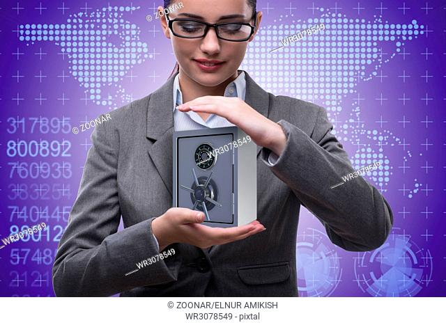 Businesswoman holding metal safe in security concept