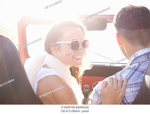 Couple in sport utility vehicle